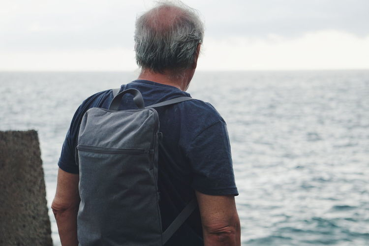 mature adult looking at sea Travel Adventure Lifestyles Traveling Water Sea Back Men Human Back Beach Standing Rear View Politics And Government Mature Men Looking At View Scenics Horizon Over Water Tranquil Scene Observation Point Hiker Rocky Mountains Tranquility Non-urban Scene Thoughtful Coast Shore Wave Idyllic Calm Remote This Is Aging