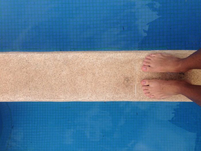 EyeEmNewHere High Angle View Water Personal Perspective Directly Above Swimming Pool Blue Textured  Built Structure Close-up No People Day Architecture Outdoors Sky Nature Clear Sky Adult People Nail Polish Human Body Part Standing Barefoot Human Leg One Person Minimalist Architecture Minimalist Architecture