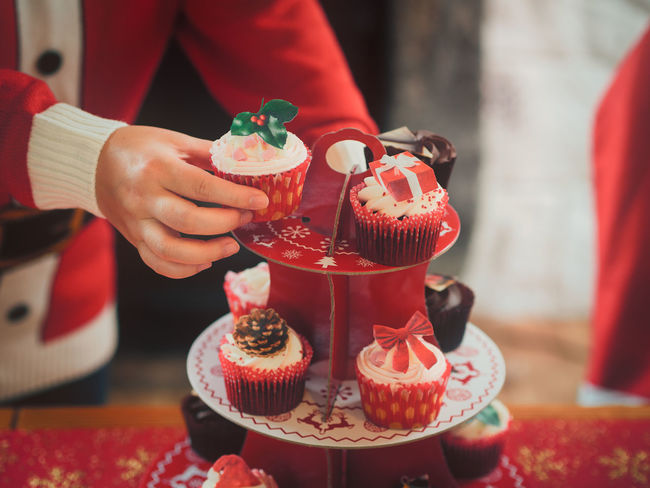 Christmas Party Close-up Day Focus On Foreground Food Food And Drink Freshness Holding Human Body Part Human Hand Indoors  Leisure Activity Lifestyles Men Midsection One Person People Real People Red Sweet Food Table Women