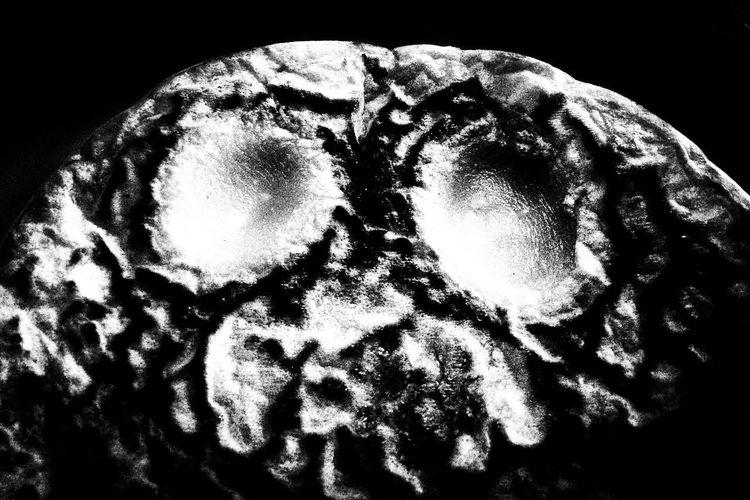Close-up of man over black background