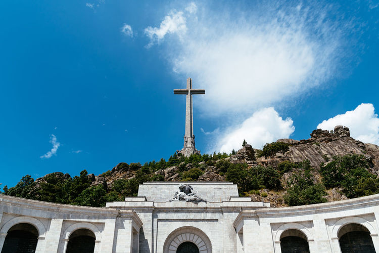 Valle de los Caidos or Valley of the Fallen monument Basilica Church Cross Historical Building Historical Monuments Spanish Civil War Tomb Tourist Attraction  Architecture Belief Built Structure Day Exhumation Fascism Francisco Franco Franco Historic Landmark Monumento Nature Outdoors Religion Sky Spirituality Travel Destinations Valle De Los Caídos Valley Of The Fallen