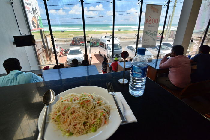 Lunch with view. Matara. Sri Lanka Ceylon Eating Food Food And Drink Indian Ocean Indoors  Lifestyles Lunch Lunch With View Lunchtime Matara Meal Noodles People Ready-to-eat Restaurant Restaurant Scene Seascape Sitting Sri Lanka Travelling Tropical Island