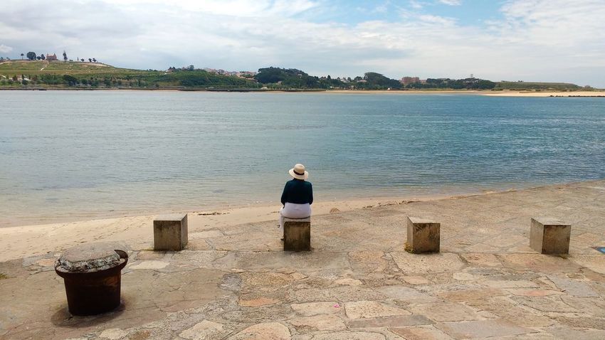 Blocks Day Duoro Estuary Hat One Person Promenade Rear View River Scenics Shore Sitting Alone Sky Water Waterfront Woman River Duoro