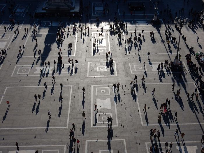 High Angle View Of People Walking On Town Square In City