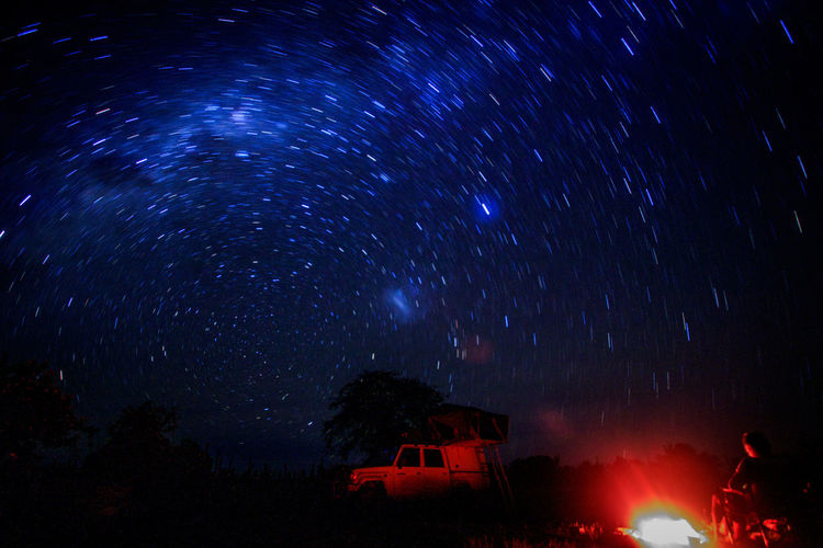 Long exposure shot of the stars and a camp fire while camping in Hwange National Park, Zimbabwe. Campfire Camping Galaxy Landcruiser  Nature Nature Photography Nightphotography Adventure Africa Astronomy Beauty In Nature Campinglife Long Exposure Night Photography Milkyway Night Outdoors Safari Scenics - Nature Sky Space And Astronomy Star Star - Space Stars Tent Toyota Landcruiser