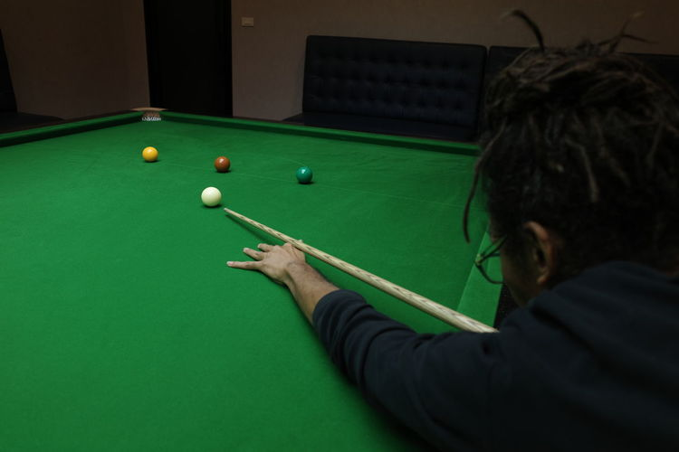 Man playing with ball on table