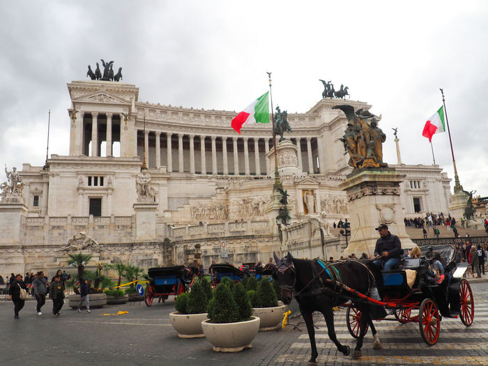 Rome Architecture Building Exterior Built Structure City Cloud - Sky Day Flag Italy Large Group Of People Mammal Outdoors Patriotism People Real People Sky Statue Travel Destinations