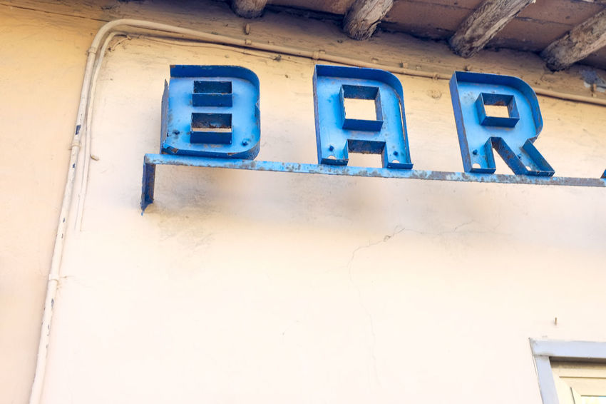 Architecture Bar Blue Building Exterior Built Structure Close-up Communication Day Font Low Angle View No People Outdoors Text Vintage