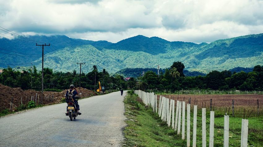 Mountain Cloud - Sky Riding Motorcycle One Person Bicycle Cycling Mountain Range Outdoors Day Landscape Sky Real People Land Vehicle Scenics Road Headwear Lifestyles Rural Scene Nature Vang Vieng Laos