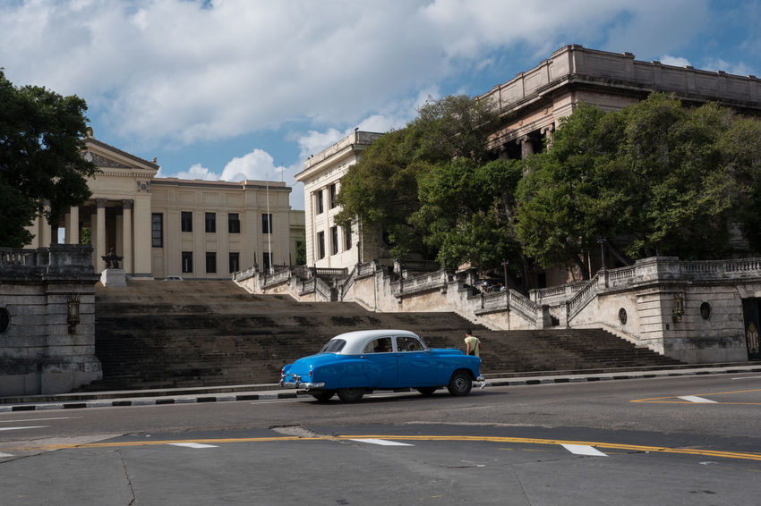 Alma Mater with different kinds of cars passing by Architecture Centro Habana City Cuba Cuba Collection Day No People Outdoors Street Travelling Photography Tree