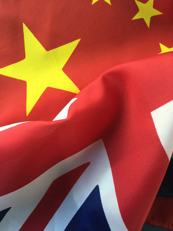 UK and China flags Backgrounds British Flag China Chinese Flag Close-up Cooperation Diplomacy Fabric Filtered Image Flags Governments Great Britain Military No People Patriotism Phone Camera Red Star Shape Textured  Union Jack Yellow
