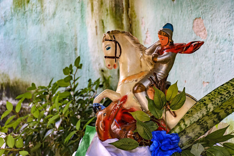 Image of St. George on his horse killing the dragon Altar Brazil Dragon Faith Legend Pray Saint George Belief Brazilian Candomblé Craft Cristianity Culture Horse No People Ogum Orixas Plant Religion Religions Religious  Spirituality Statue Syncretism Umbanda