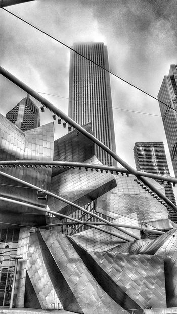 Jay Pritzker Pavilion in the city of Chicago Architecture Black & White Chicago Chicago Architecture City Jay Pritzker Pavilion Skyscrapers Tourist Attraction  Architecture Art B&w B&w Photography Black And White Blackandwhite Blackandwhite Photography Building Exterior Buildings & Sky Built Structure City Landmark Low Angle View Modern Skyscraper Tourism Tourism Destination