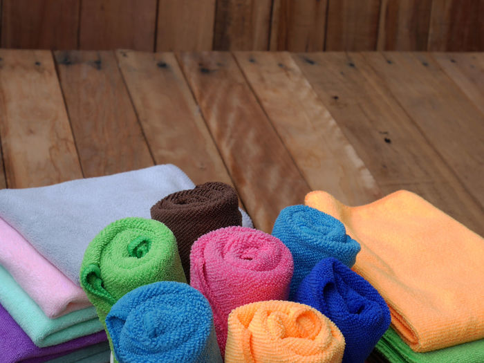 Colorful rolled bath towels on wooden background Background Bath Bathroom Beauty Blue Body & Fitness Care Clean Close-up Cloth Colorful Cotton Dry Fabric Hygiene Laundry Luxury Pile Pink Soft Spa