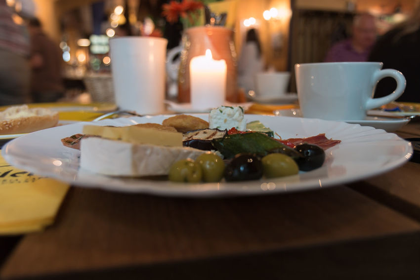 Cheese with olives. Bokeh Candle Cheese Close-up Day Flame Food Food And Drink Freshness Healthy Eating Indoors  No People Nusshain 06 17 Olives Plate Ready-to-eat Selective Focus Table Temptation