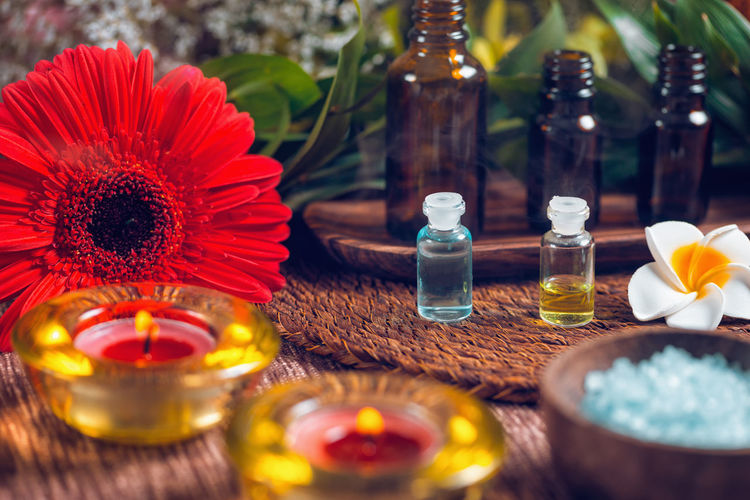 Aromatherapy Aromatherapy Aromatherapy Oil Essential Oils Orange Red Bottles Spa Wellness Relax Glass Therapy Sea Salt Blue Natural Aromatic Brown Care Treatment Healthy Perfume Candles Essence Green Fragnance Organic Health Aroma Fresh Alternative Relaxation Lifestyle Decoration Cosmetic Ingredient Skincare No People Flower Table Candle Bottle Indoors  Close-up
