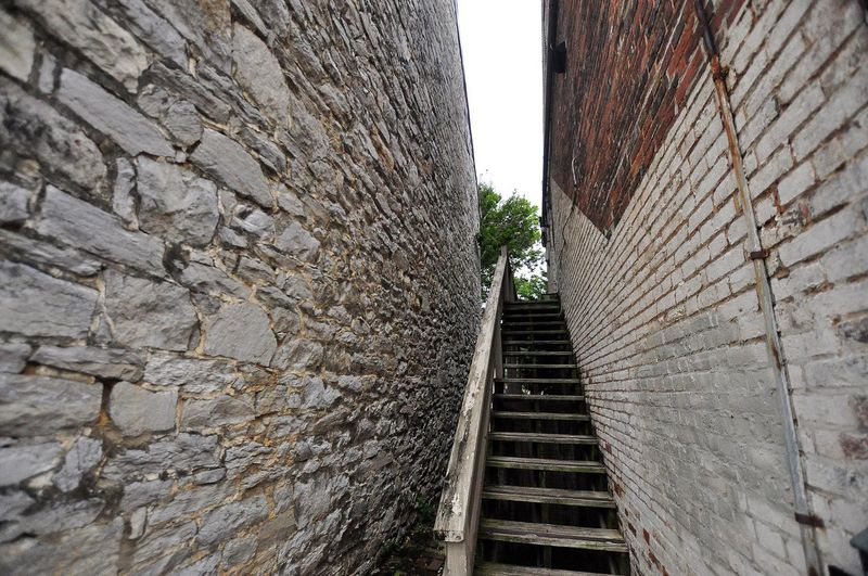 Walls Walking Around Winchester, VA Winchester - Old Town Textures And Surfaces Textured  Rough Texture Stairway Walking Around Travel Photography Angles And Lines Oldbrick Alleyscapes Ourdoors Traveling Tree Sky Roughedges Woodenstairs Smailltownusa Striations