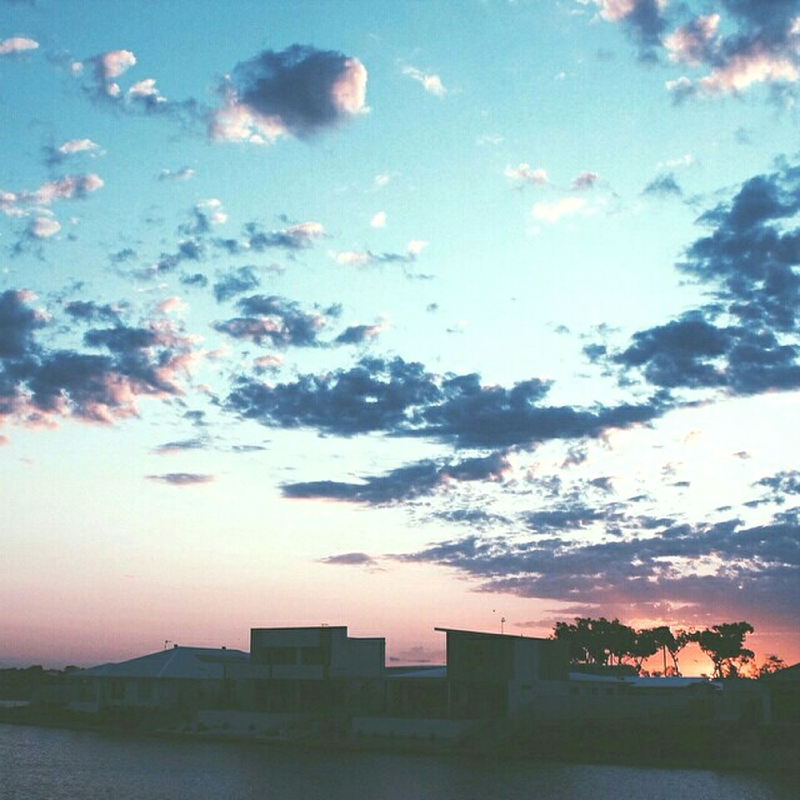sunset, building exterior, architecture, built structure, sky, cloud - sky, orange color, house, cloud, residential structure, residential building, cloudy, beauty in nature, scenics, city, nature, silhouette, outdoors, building, dusk