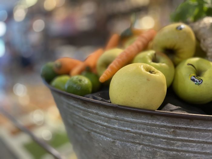 Close-up of fruits in container at market stall