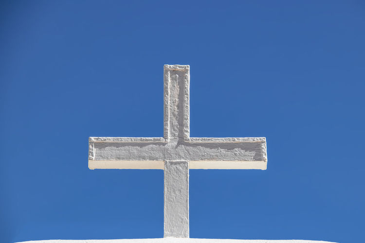 White adobe cross against a very blue sky - closeup Cross Religion No People Sky Cross Shape Copy Space Symbol Belief Blue Church Architecture Pueblo Indigenous  Stucco White USA Taos Simipl Southwest  New Mexico Christian Spanish Worship Catholic Mission