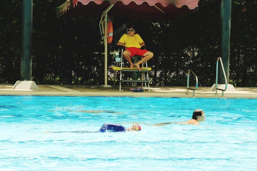 Enjoy The New Normal Swimming Pool Water Swimming Full Length People Friendship Vacations Adult Outdoors Adults Only Day For The Love Of Photography Eyeem Singapore EyeEm Gallery