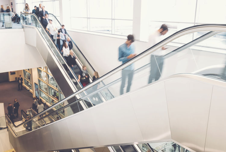 High angle view of people standing on escalator