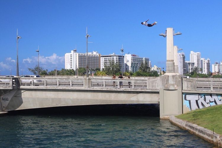 Bridge jumping Architecture Built Structure Building Exterior Water Bridge - Man Made Structure Day River Outdoors Transportation Connection Waterfront Travel Destinations City Bird No People San Juan PR Clear Sky Sky Nature RISK Jump Jumping Crazy Crazy Kid Puerto Rico