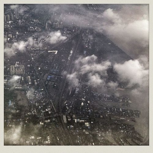 Cityscape through the clouds, this is Pune approaching. Taken from flight 9w618