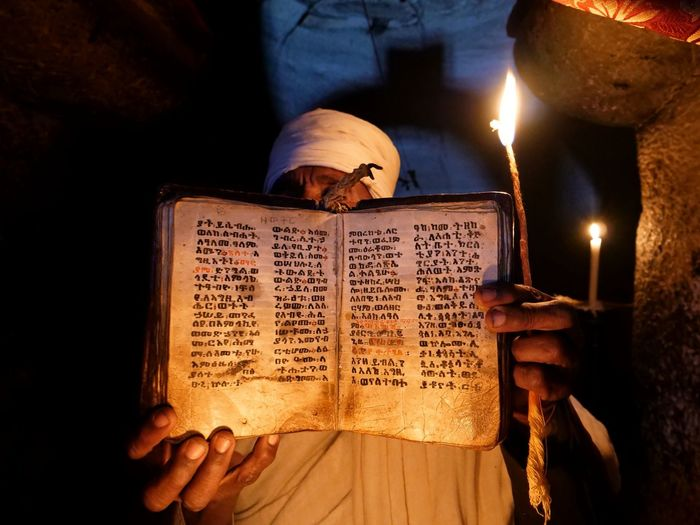 Bible Tigrinya Skin Candle Priest Rock Church Tigray Mountains Agame Mountains Ethiopia Africa Spirituality Religion Close-up Written Flame Burning Candlelight The Traveler - 2019 EyeEm Awards The Photojournalist - 2019 EyeEm Awards