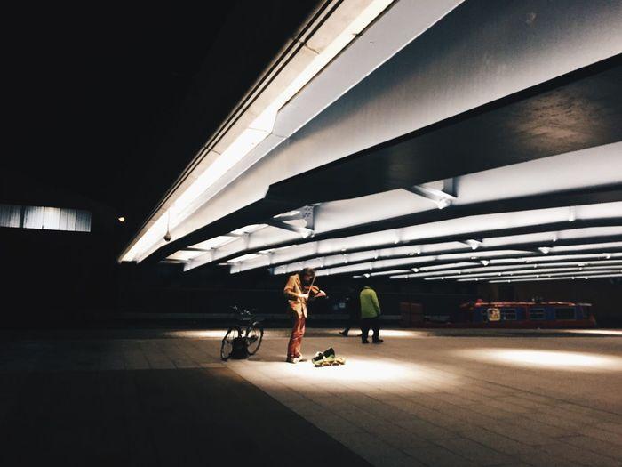 People on illuminated footpath