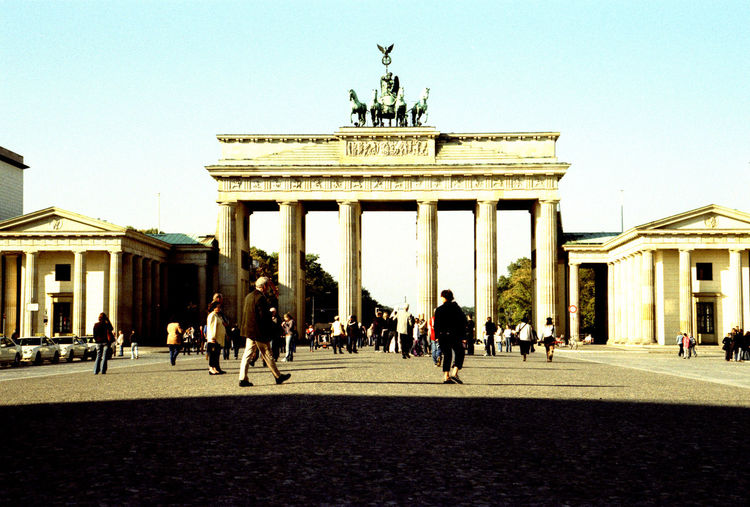 Brandenburg Gate Berlin Germany Berlin Brandenburg Gate Architectural Column Architecture Building Exterior Built Structure City City Gate City Life Clear Sky Day History Monument Outdoors Statue Tourism Travel Travel Destinations