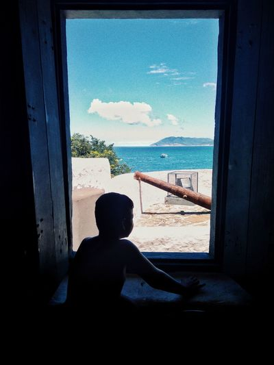 Window Looking Through Window Silhouette Sea Indoors  Beach One Person Water People Leisure Activity Day Child Sky Childhood Adult Real People Architecture