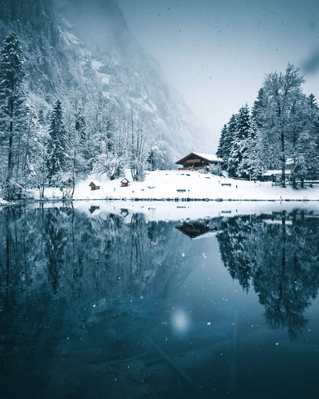 Reflection Perfection Reflection The Week On EyeEm Architecture Beauty In Nature Blausee Building Exterior Built Structure Cold Temperature Frozen Lake Mountain Nature No People Outdoors Reflection Scenics Sky Snow Tranquil Scene Tranquility Tree Water Waterfront Weather Winter