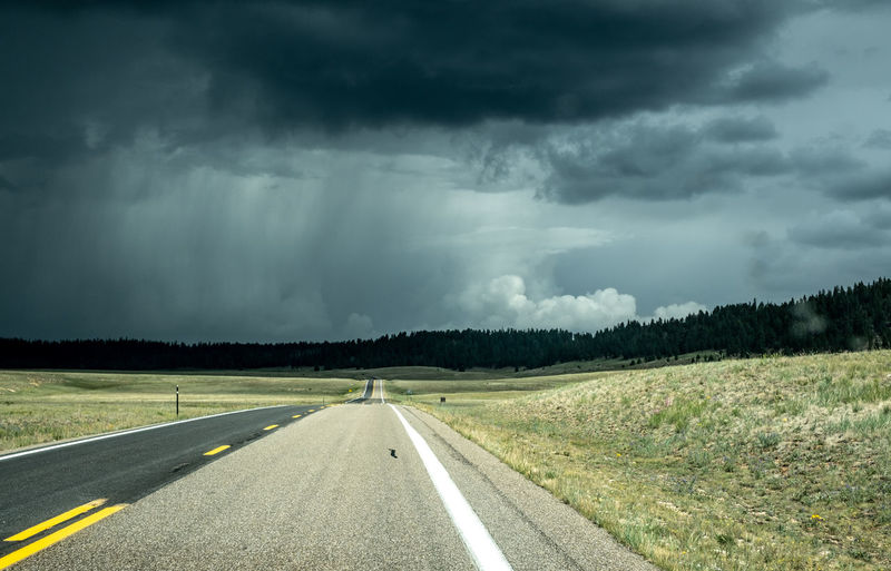 USA Beauty In Nature Cloud - Sky Direction Environment Highway Landscape Marking Nature No People Non-urban Scene Ominous Outdoors Rain Road Road Marking Sign Sky Storm Storm Cloud Symbol The Way Forward Transportation