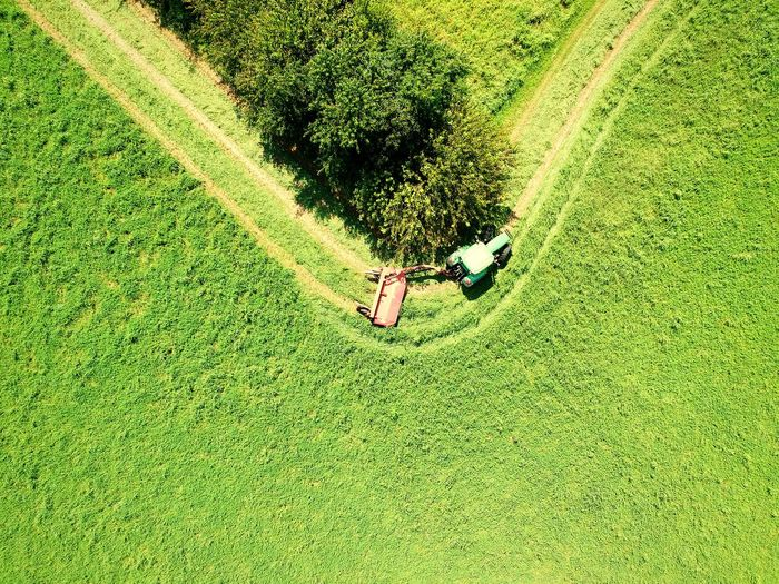 Aerial view of tractor over field at farm