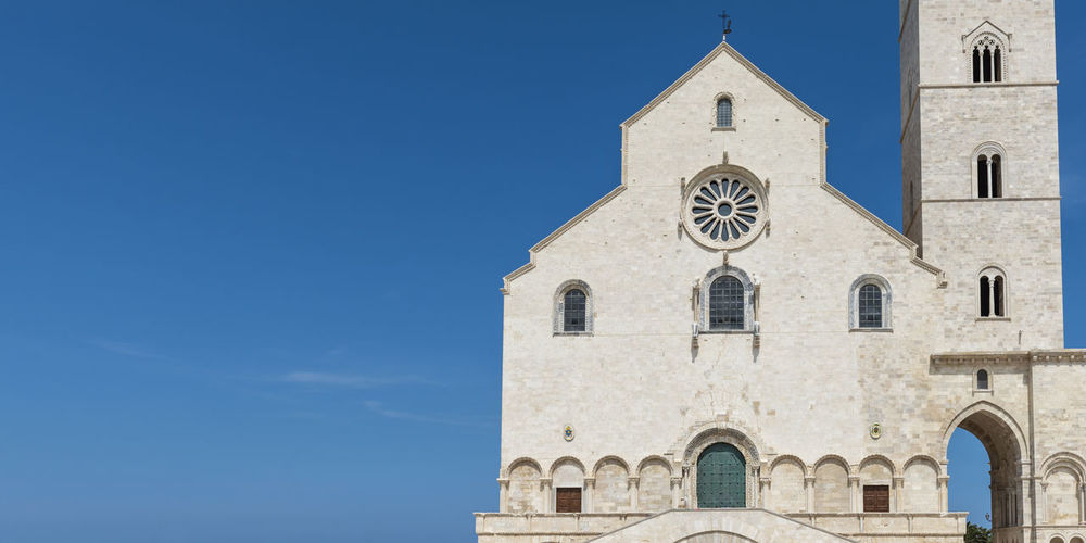 Like a white ship in the middle of the sea. Trani, cathedral of San Nicola Pellegrino. Puglia. Italy Architecture Building Exterior Built Structure No People Church Church Architecture Church Tower Church Buildings Trani Cathedral Apúlia Apulia Italy Italia Puglia Apulian Landscape Architecture Architecture And Art Italy Religion Religion Architecture Building Building Story Buildings & Sky Puglia Sea And Sky Romanesque Architecture Monument Historical Historical Building Historical Place Religious  Tourism Tourism Destination Tower Arch Travel Travel Destinations Landmark Landmark Building Ancient Ancient Architecture Square Stone Culture Facade Building Bari Medieval Architecture Medieval City Oldtown Italian Italian Style Culture And Tradition The Traveler - 2019 EyeEm Awards