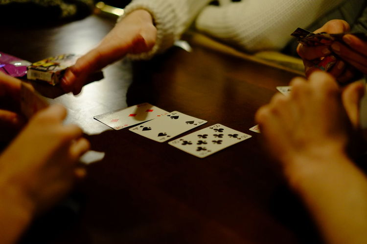 Card Card Games Cards Gambling Holding Human Body Part Indoors  Leisure Activity People Playing Cards Poker Real People