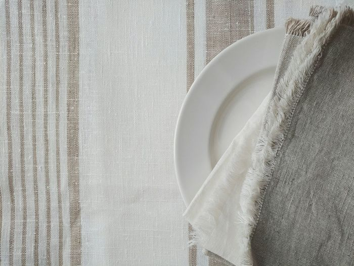 High angle view of napkins in plate on table