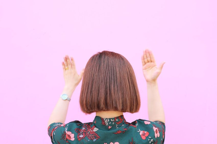 Architecture EyeEmNewHere Fashion Taking Photos Wall Built Structure Copy Space Enjoying Life Hair Hairstyle Headshot Human Body Part Lifestyles Minimalism Obscured Face One Person People Pink Background Pink Color Portrait Simplicity Style Wall - Building Feature Woman Portrait Women