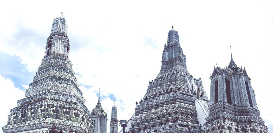 Wat Arun Ratchawararam Ratchawarama EyeEm Selects Built Structure Low Angle View Sky Architecture Building Exterior Place Of Worship Tall - High Religion Tourism Outdoors Building Travel Destinations Spire  No People Belief Spirituality Tower Nature City Day