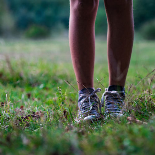 Shoes Low Section One Person Human Leg Grass Human Body Part Body Part Plant Selective Focus Land Standing Nature Field Day Lifestyles Real People Shoe Leisure Activity Human Foot Outdoors Limb