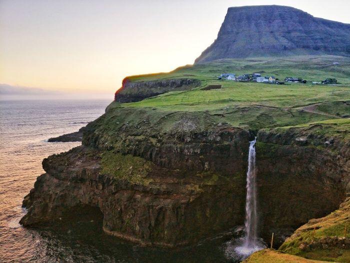 Gasaladur on Faroe Islands with waterfall Waterfall Faroe Islands Gasaladur Water Sea Sunset Mountain Cliff Rock - Object Sky Landscape Rocky Mountains Waterfall Natural Landmark Falling Water