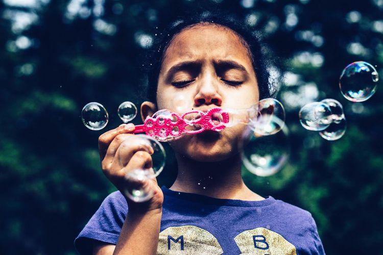 Portrait of mature man holding bubbles