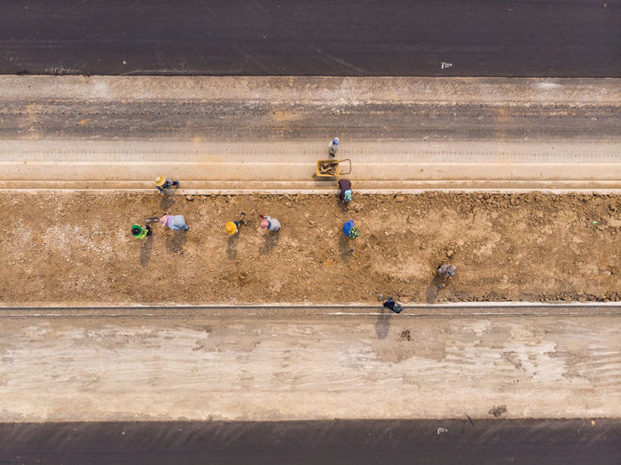 High angle view of people working on road