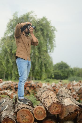 EyeEmNewHere Rural Scene Woodlog Logs Pile Wood Singh Sardar Sikh Photography Outdoors Nature Sky Tree Blue Sky Green Harayana Indian Farms Country Life Countryside Focus Photographer Photoshoot Woodpile Punjab Brown EyeEmNewHere