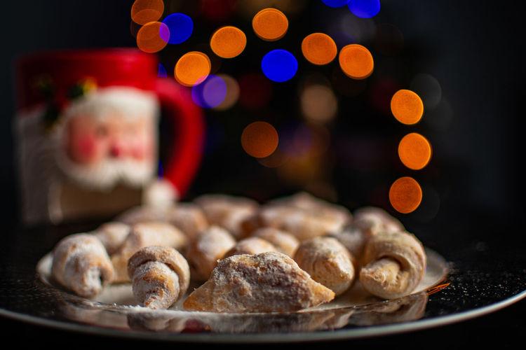 Christmas dinner dessert with bokeh lights background