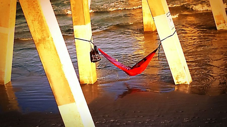 Hammock Lounging In Hammock Under The Pier Life Is A Beach Beachphotography Lounging Around Relaxation Relaxing Relaxing In The Sun Learn & Shoot: Simplicity