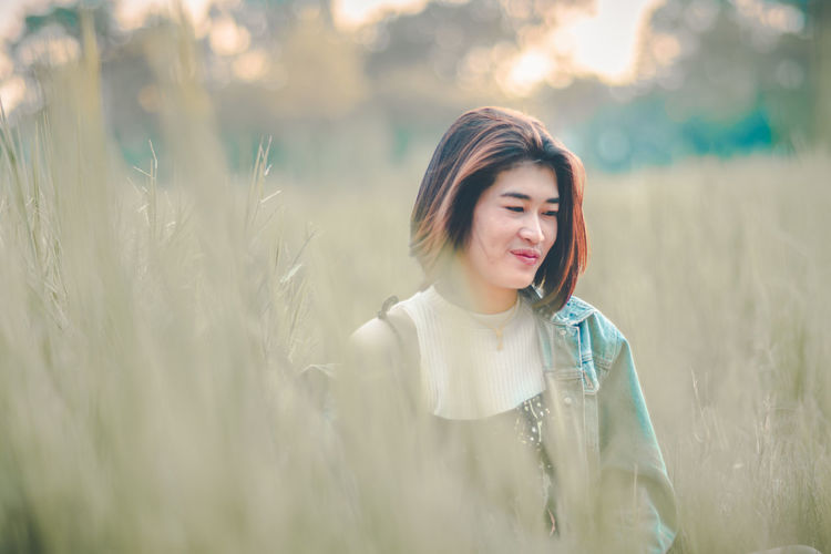 Adult Asian Teen Asian Teenager Beautiful Woman Beauty Casual Clothing Contemplation Front View Hairstyle Happiness Land Leisure Activity Nature One Person Outdoors Portrait Smiling Women Young Adult Young Women