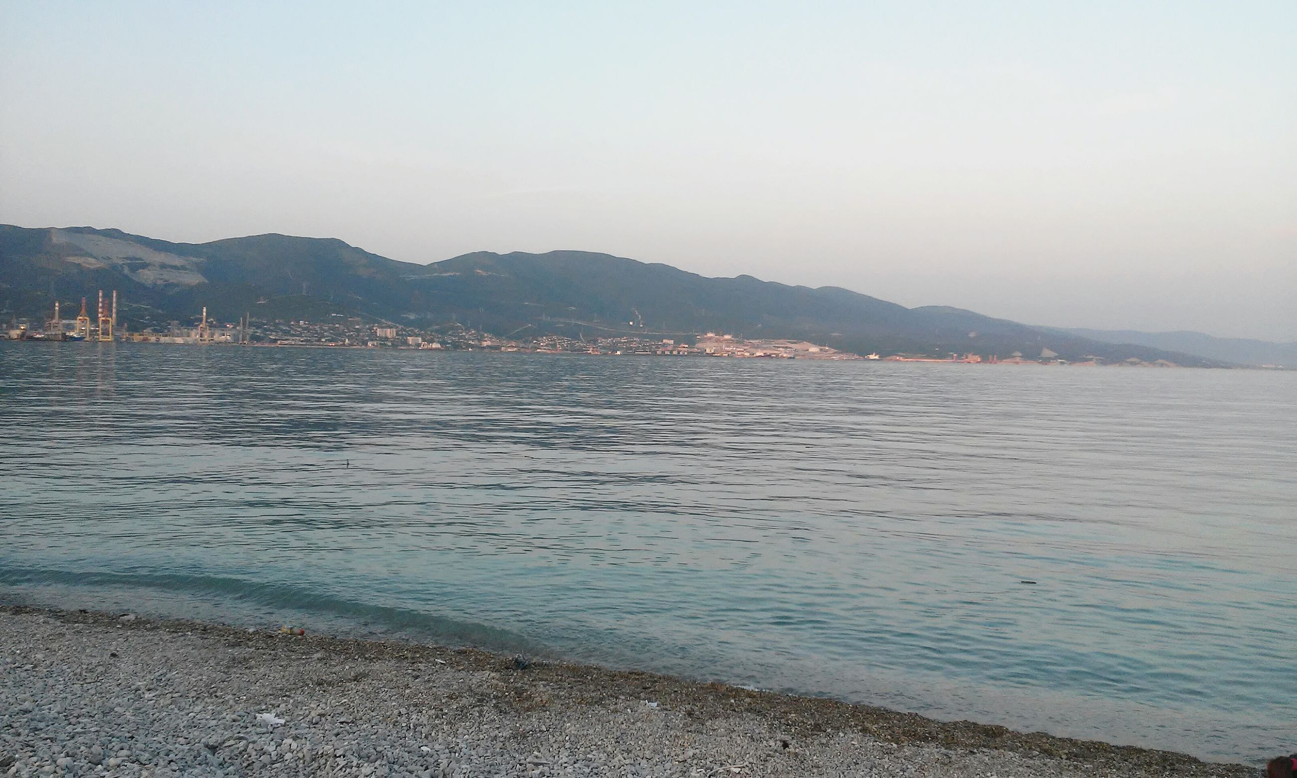 water, mountain, sea, tranquil scene, scenics, tranquility, clear sky, mountain range, beauty in nature, copy space, beach, nature, sky, shore, lake, idyllic, coastline, outdoors, waterfront, nautical vessel