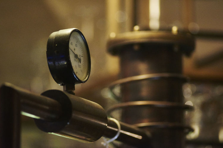Close-Up Of Gauge On Distiller